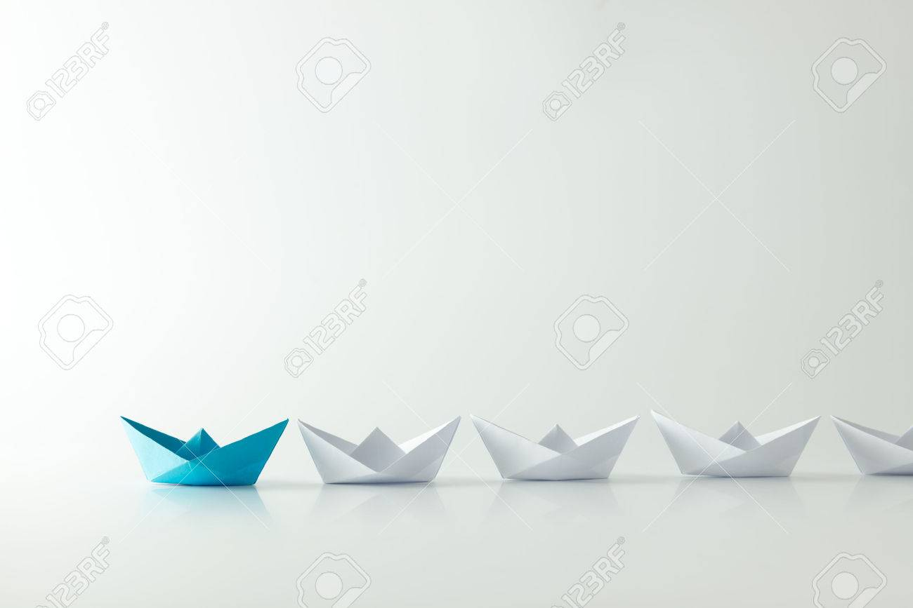 Leadership concept with blue paper ship leading among white Stock Photo - 45688472