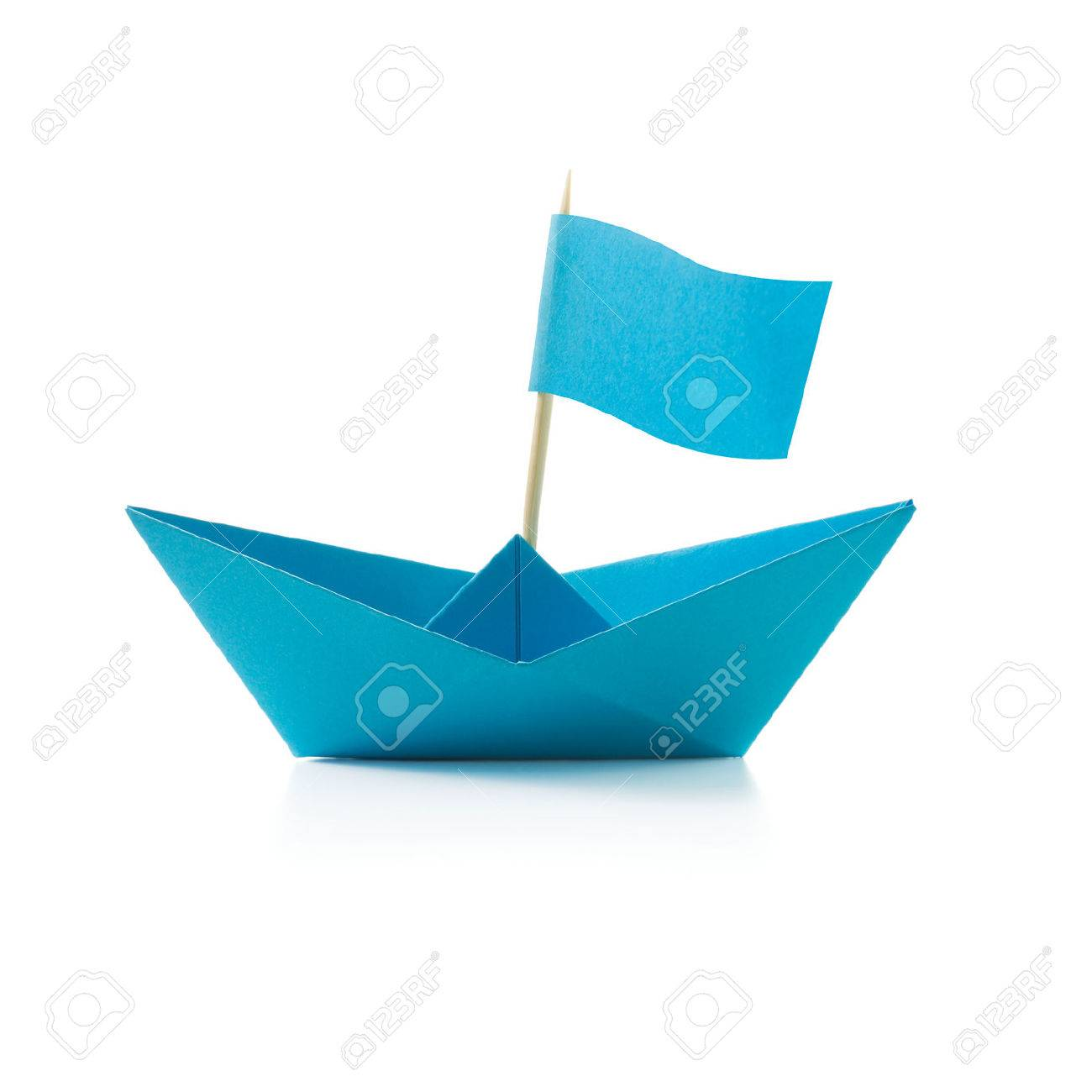 Origami Blue Paper Boat With Flag On White Background Stock Photo