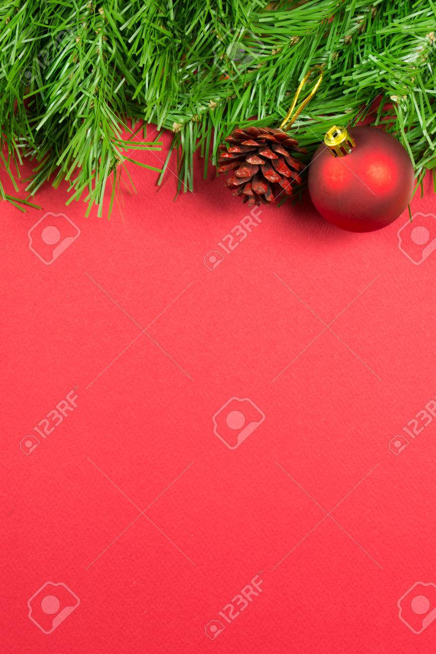 Christmas decoration over red background, with copy space - 48925311