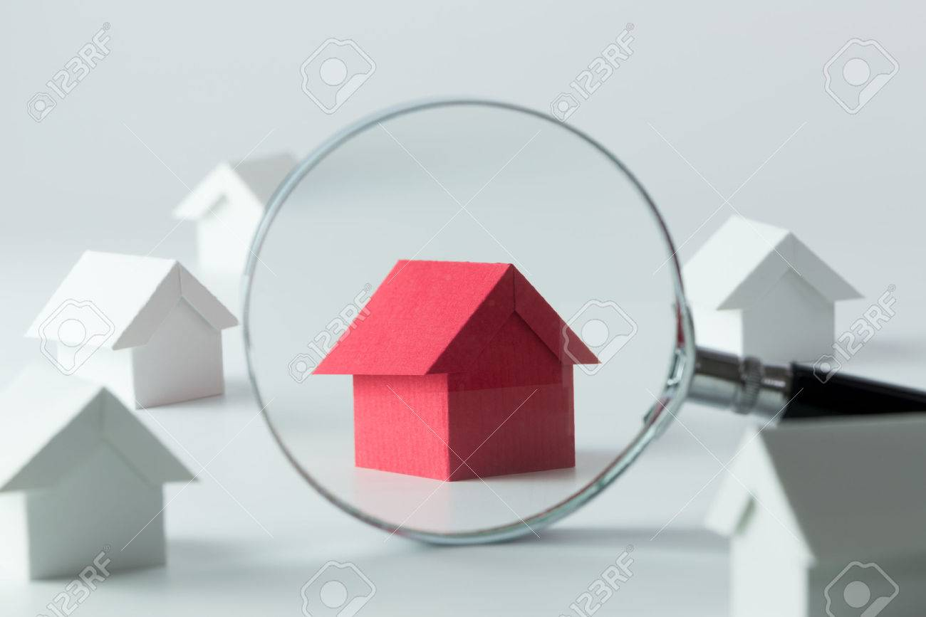 House searching concept with a magnifying glass - 57836301