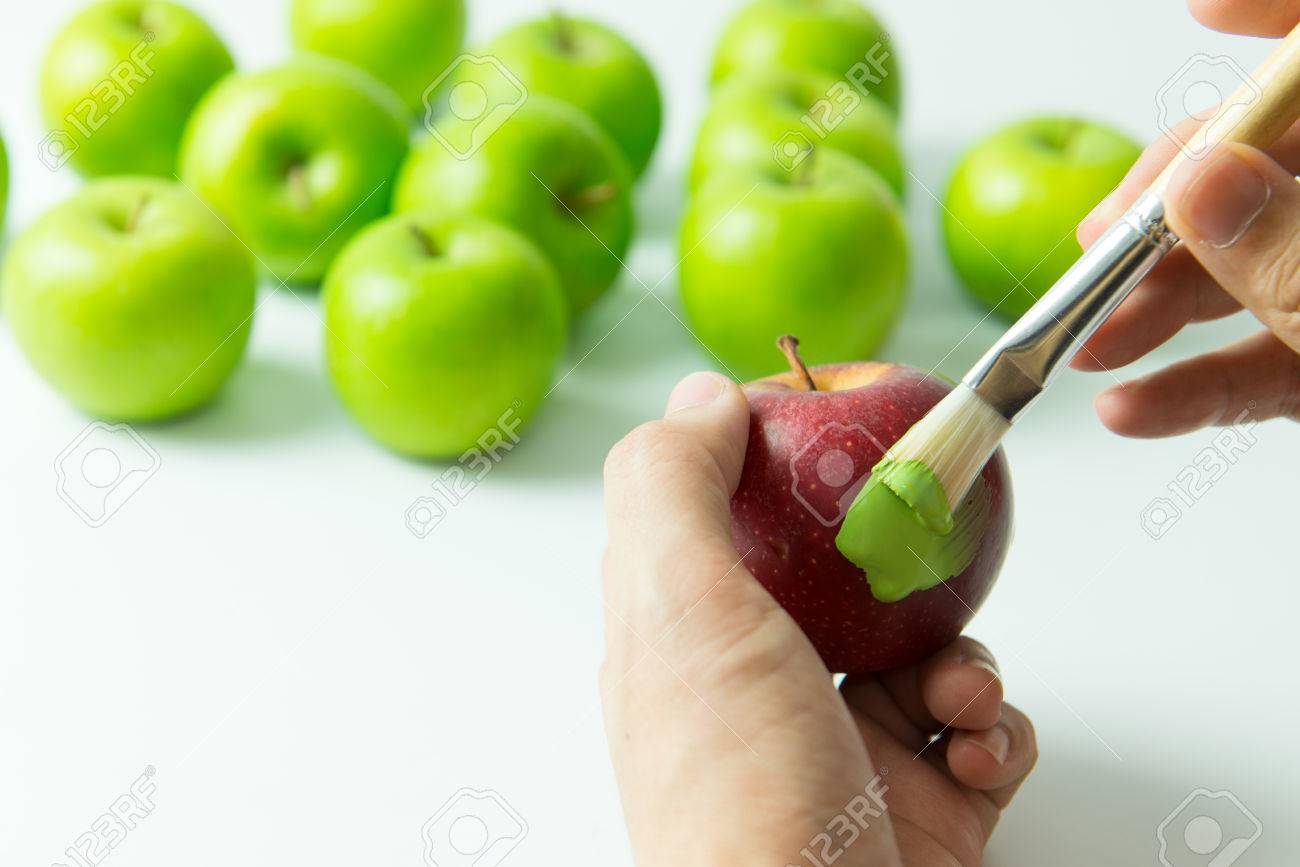 concept of by painting red apple into green color stock photo - Apple Green Color