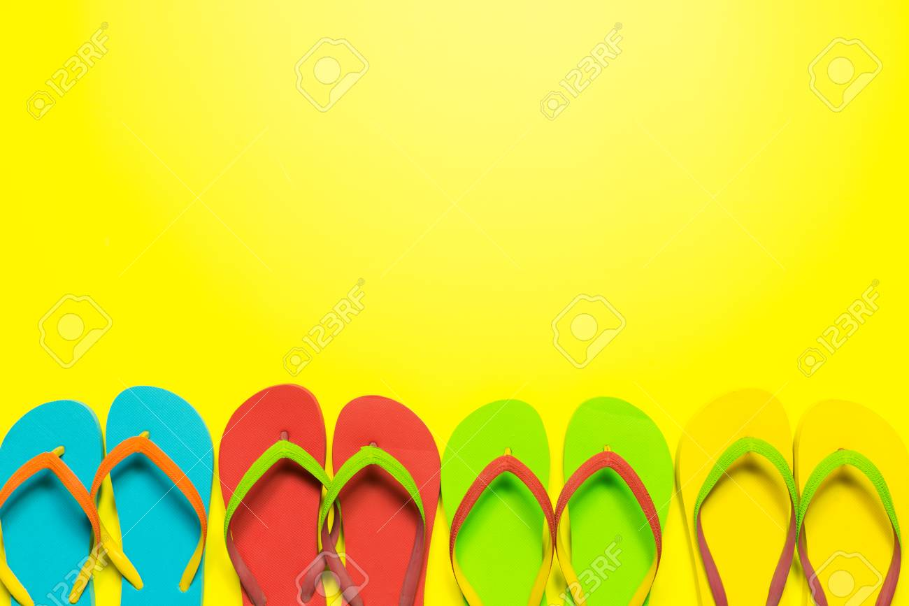 59fd40720 Multicolor Flip Flops On Yellow Background
