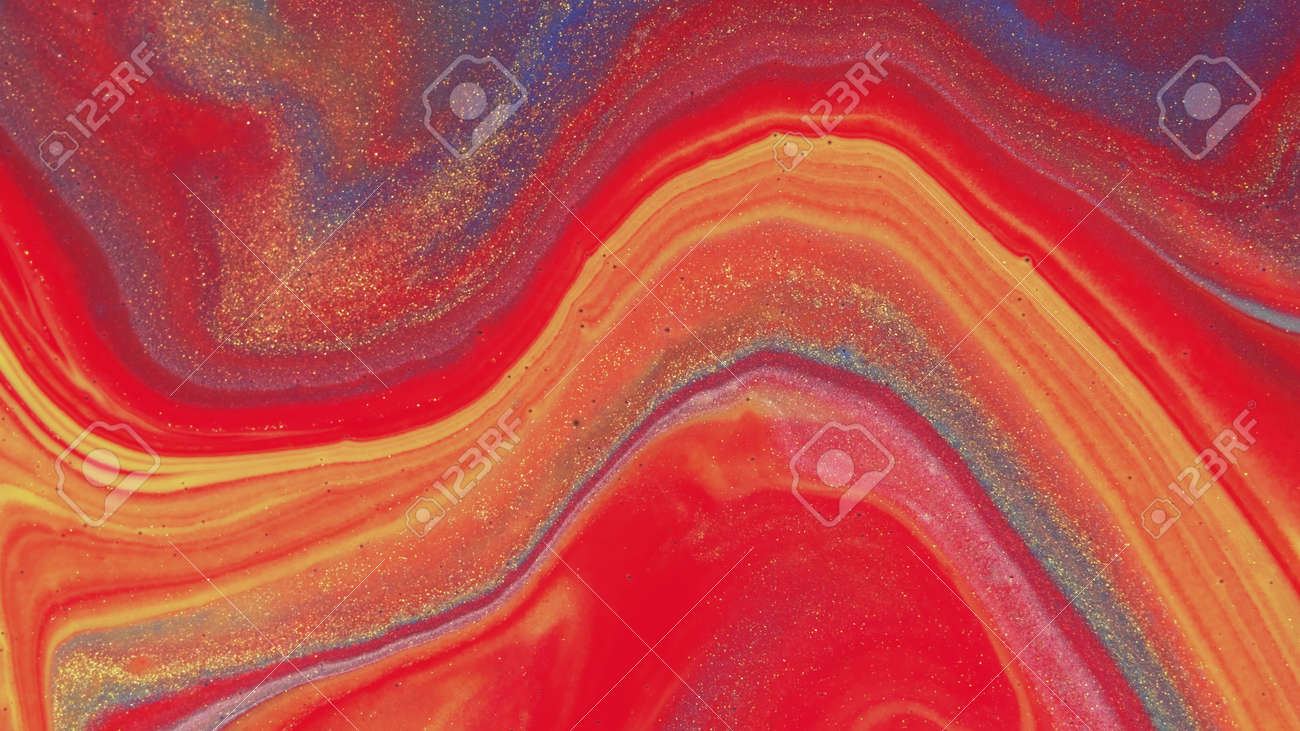 Abstract colorful background of spreading colors. Abstract red paint background. - 165387540