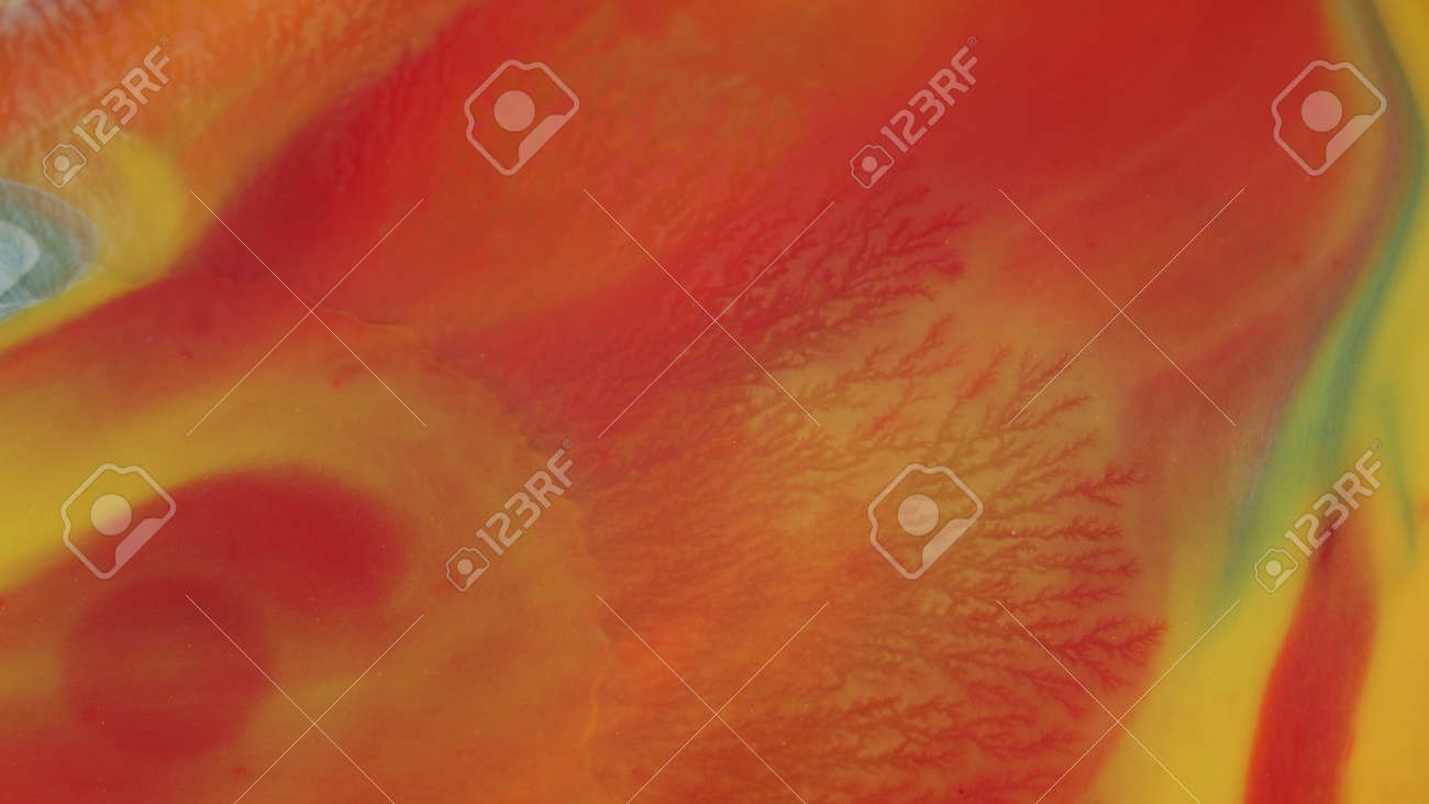 Abstract colorful background of spreading colors. Abstract red paint background. - 165524141
