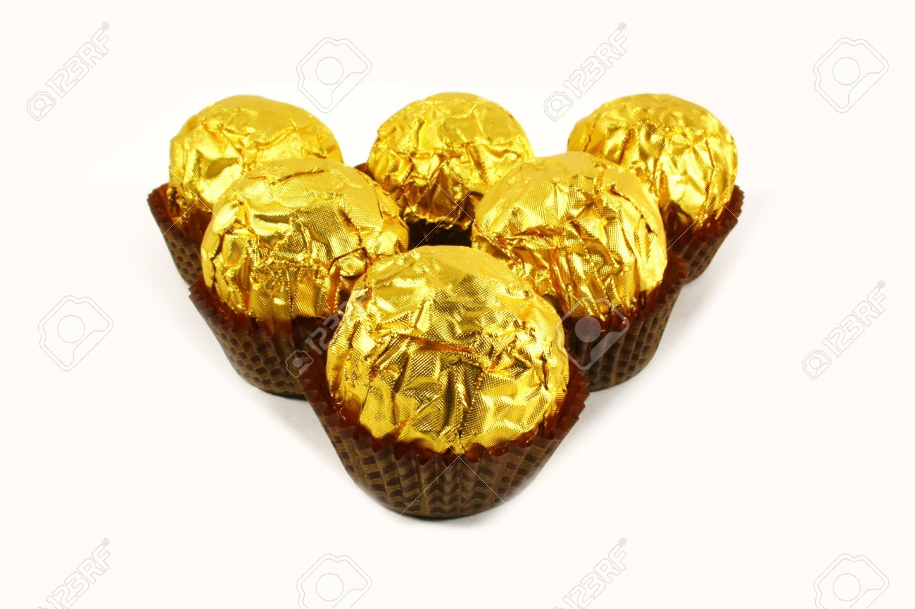 Fancy Chocolates Wrapped In Tin Gold Foil Stock Photo, Picture And ...
