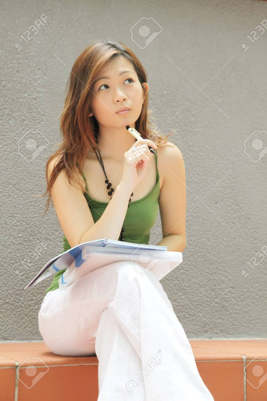 Asian Lady Thinking and Curious with Pen Stock Photo - 5251190