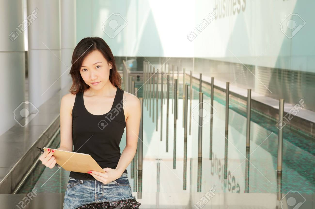 Asian Young Career Woman Outside an Office Stock Photo - 5306705