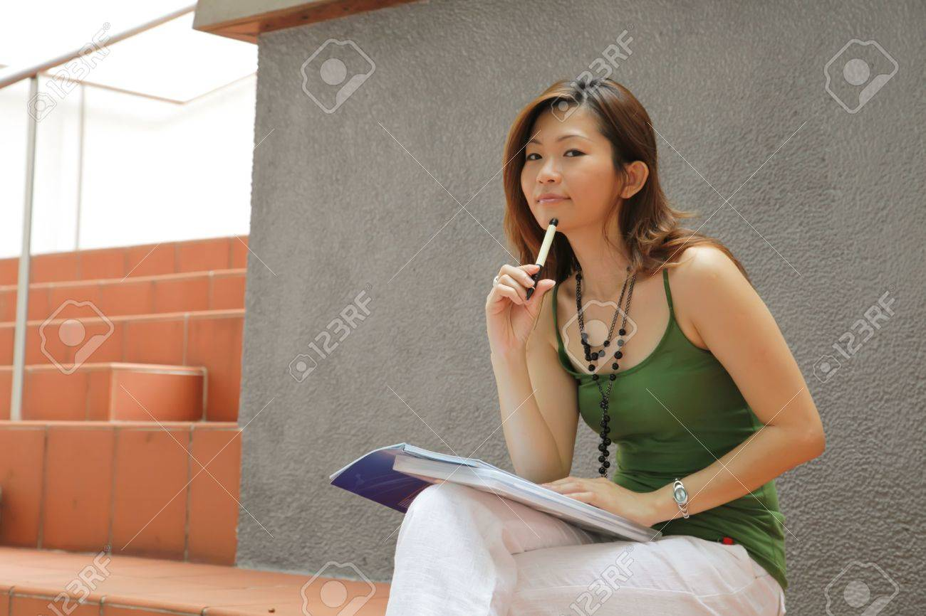 Asian Young Career Female Outside an Office Stock Photo - 5314107