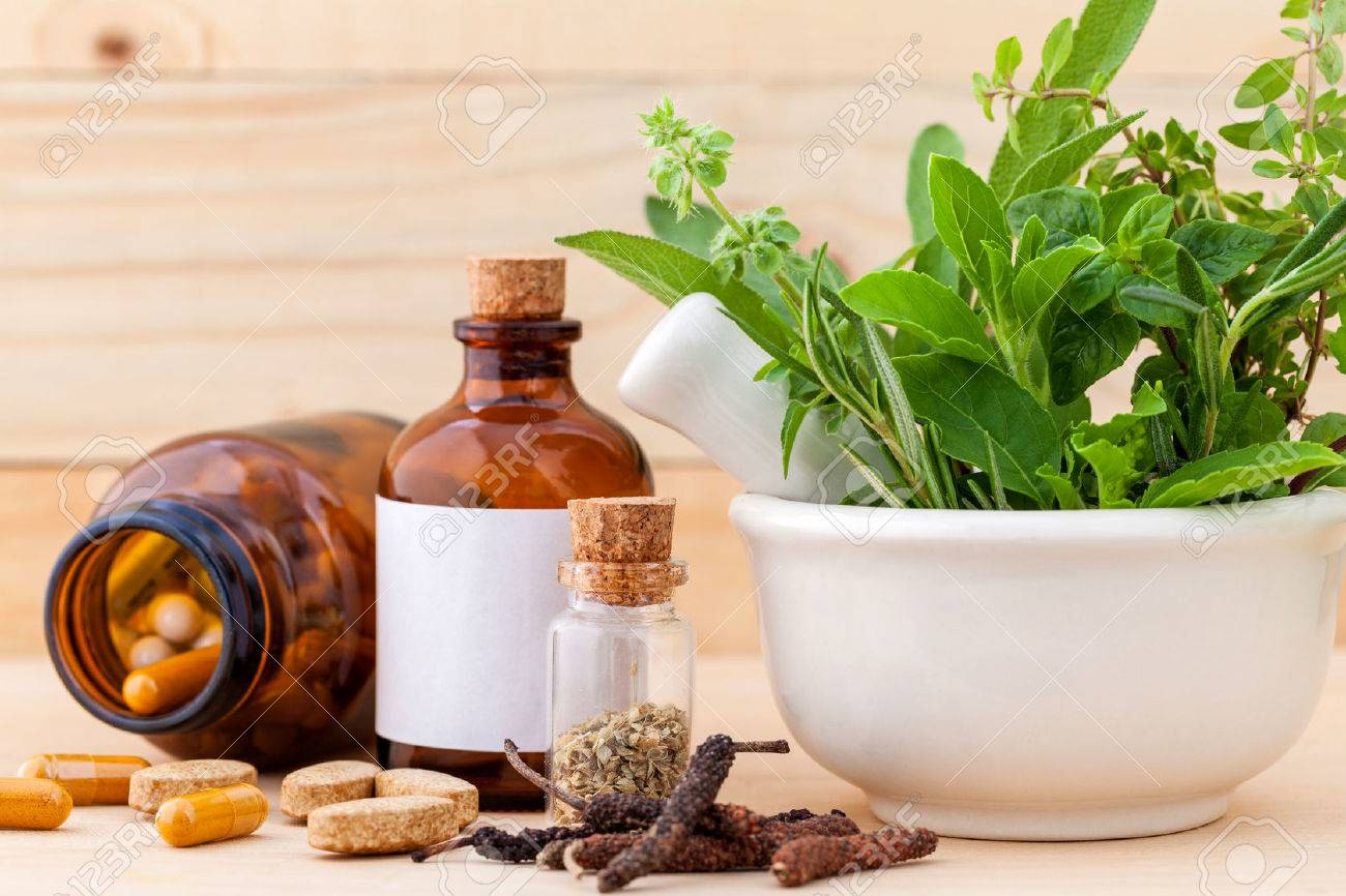 Alternative health care fresh herbal ,dry and herbal capsule with mortar on wooden background. - 44135333
