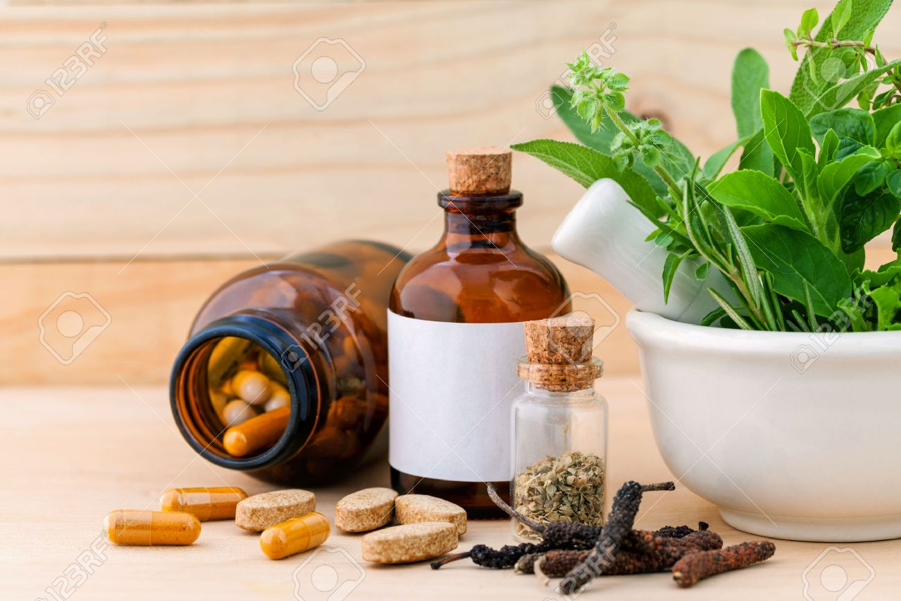 Alternative health care fresh herbal ,dry and herbal capsule with mortar on wooden background. - 44133645