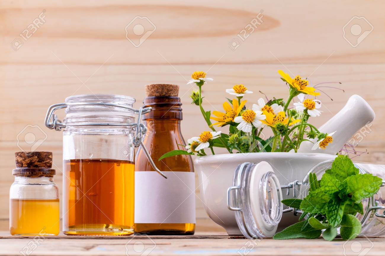 Alternative health care fresh herbal ,honey and wild flower with mortar on wooden background. - 48355391