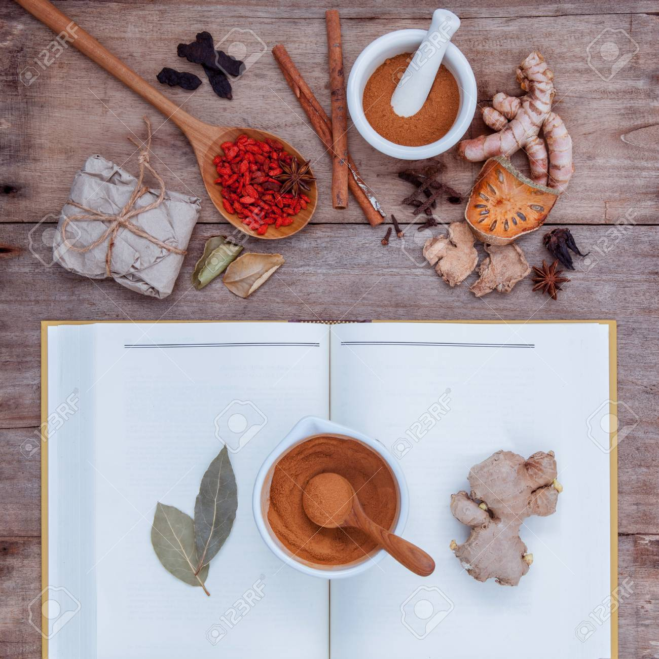 Alternative health care dried various Chinese herbs in wooden spoon with mortar on old wooden background. - 51659591