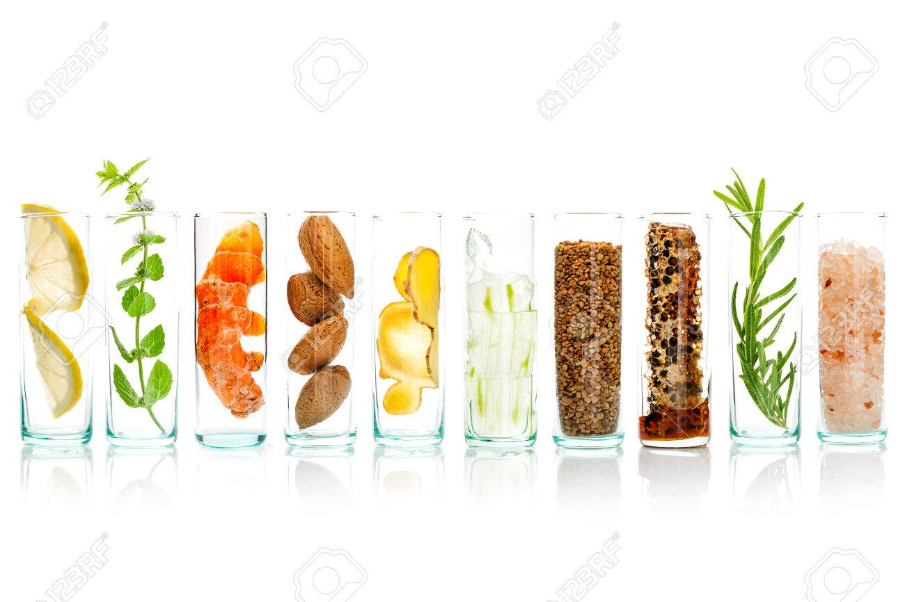 Homemade skin care and body scrubs with natural ingredients aloe vera ,lemon,cucumber ,himalayan salt ,peppermint ,lemon slice,rosemary,almonds,ginger and honey pollen in glass bottles isolate on white background. - 65511869