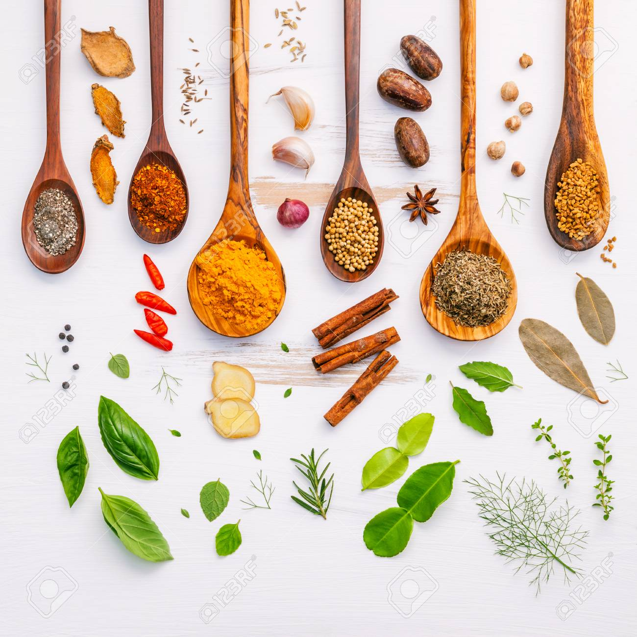 Flat lay of spices ingredients chilli ,pepper, garlic,dries thyme, cinnamon,star anise, nutmeg,rosemary, sweet basil and kaffir lime on wooden background. - 65512588