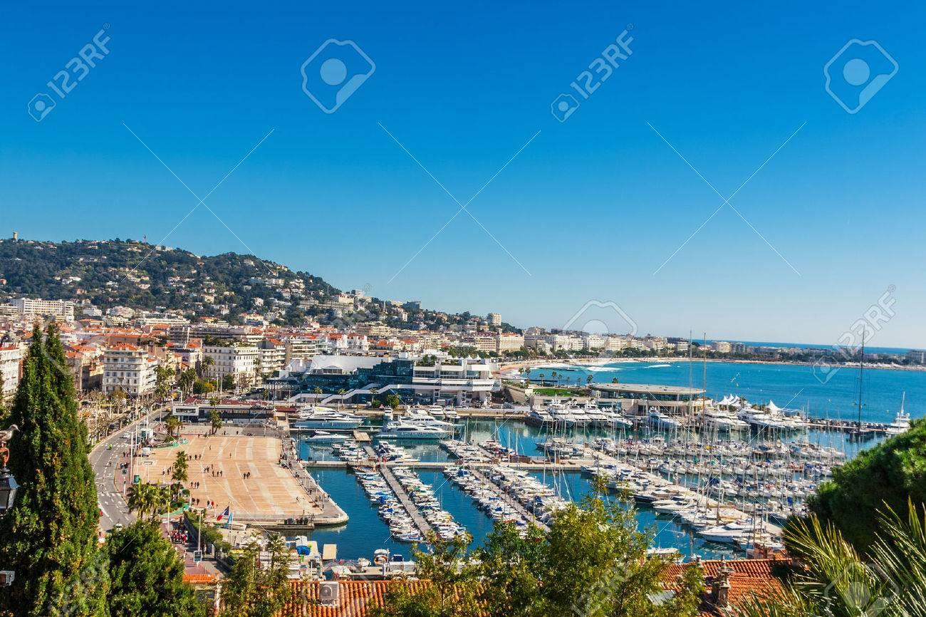 Panoramic view of Cannes, Promenade de la Croisette, the Croisette and Port Le Vieux of Cannes, France Cote d'Azur - 54469427