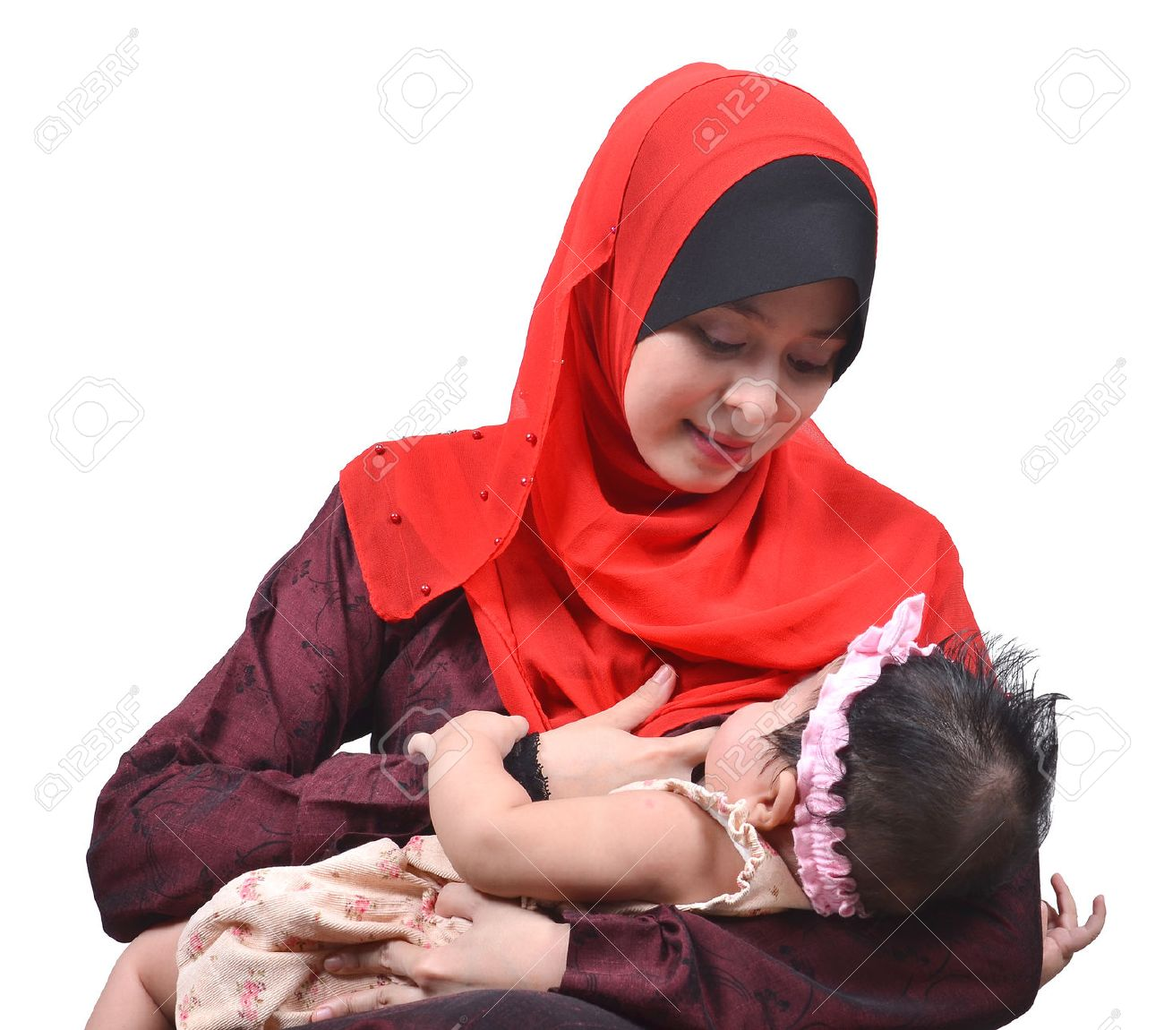 Stock photo young asian muslim mother breastfeeding her cute baby girl isolated on white background