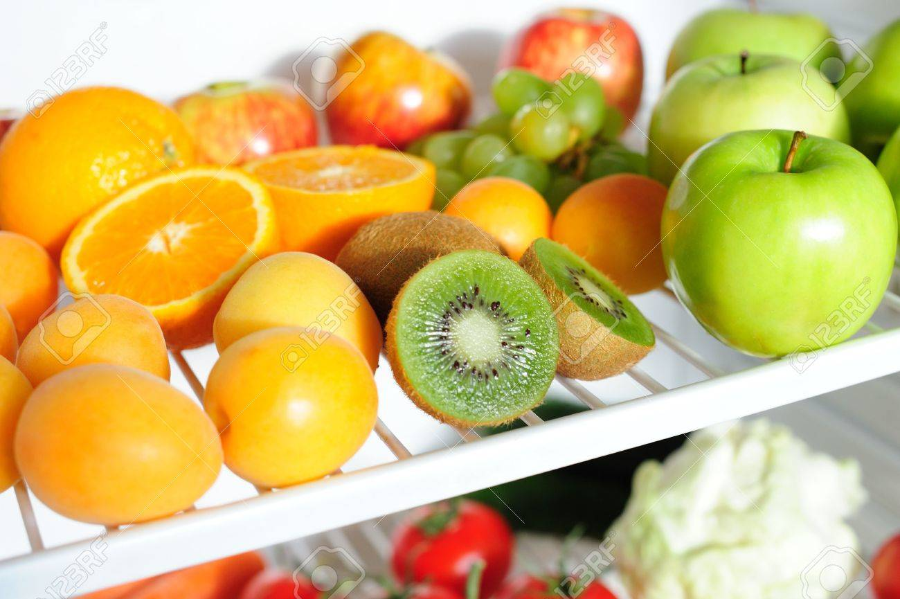 Fresh Fruit On A Shelf Of A Fridge Stock Photo Picture And Royalty