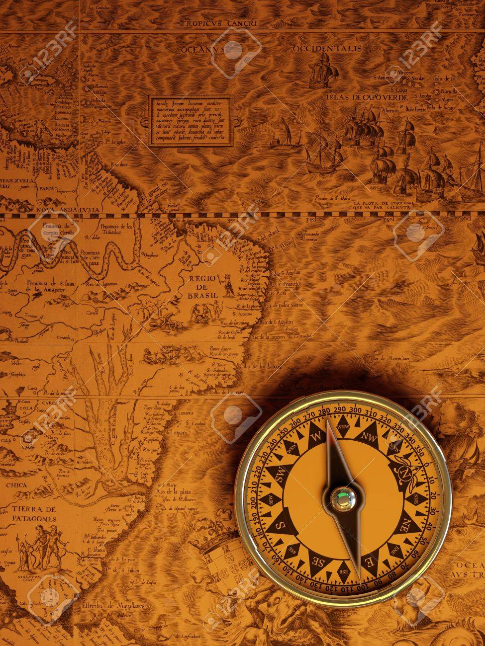 Antique brass compass over old map background Stock Photo - 4418056