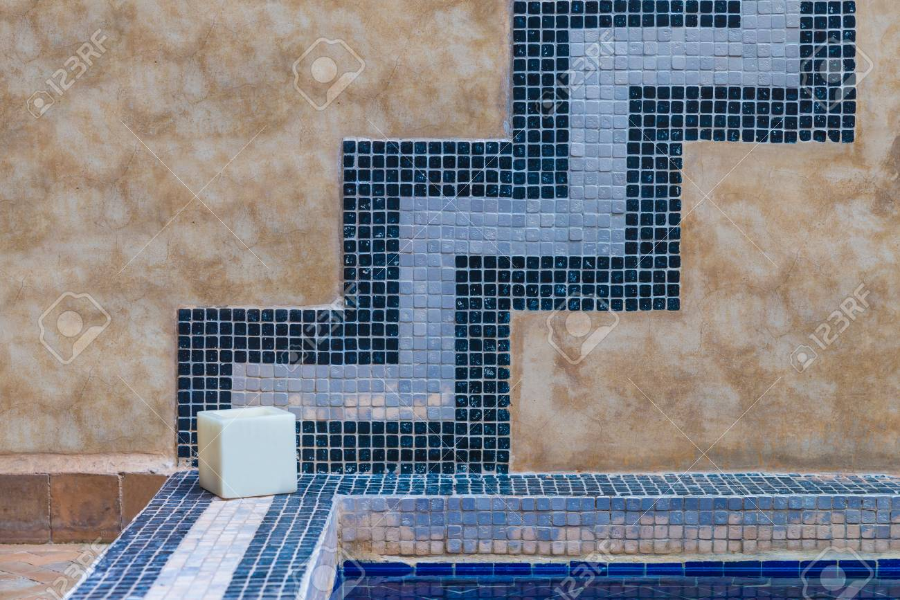 The Cement Wall Decorates With Blue Tile With Square Candle Stock ...