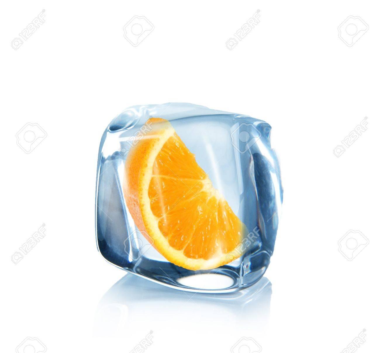 Orange slice in Ice cube over white Stock Photo - 14517047