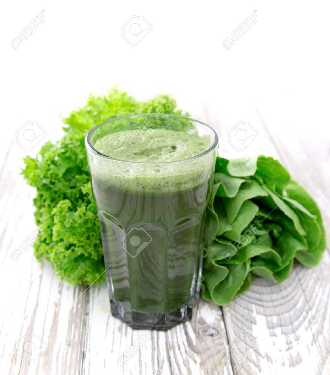 Healthy green vegetable juice on wooden table - 21861376