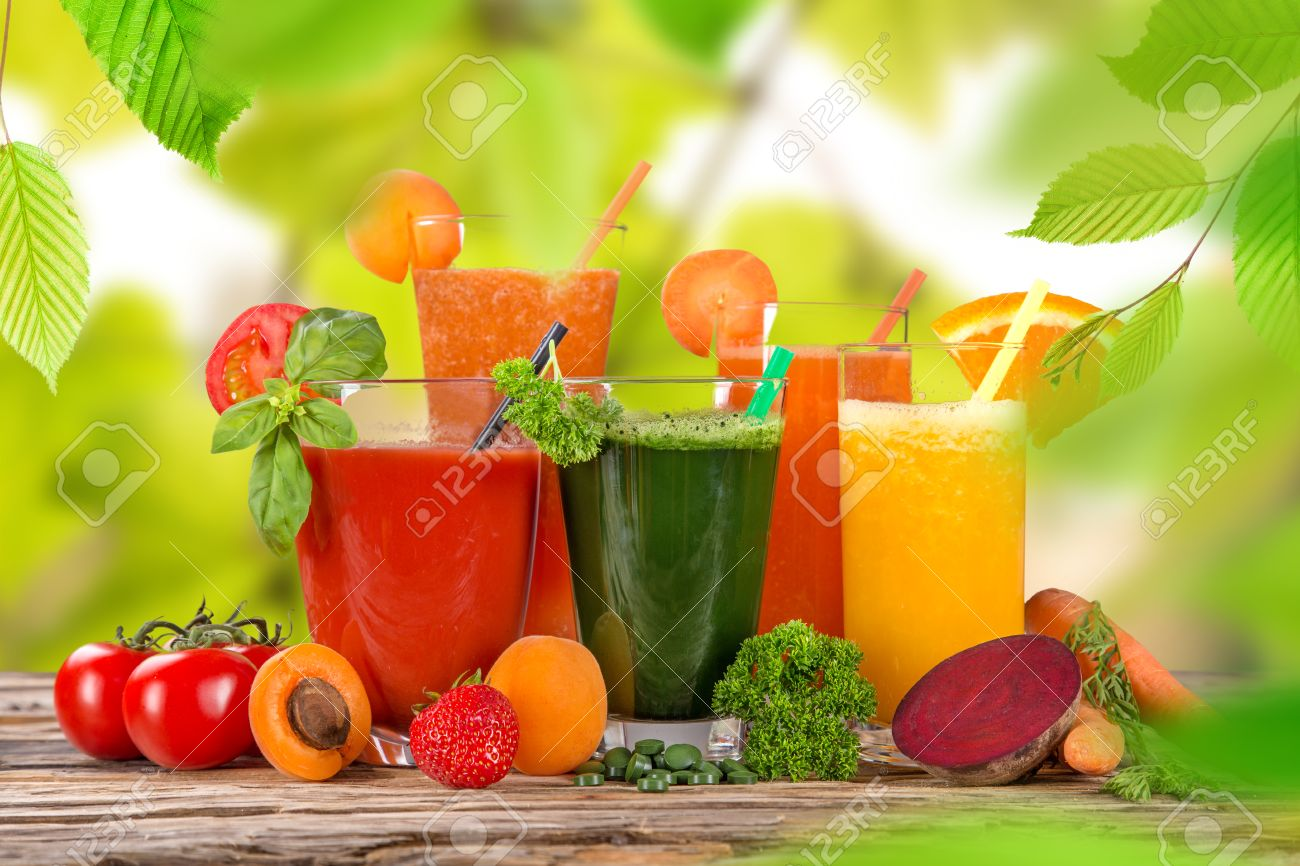fresh fruit juice on wooden table stock photo picture and royalty
