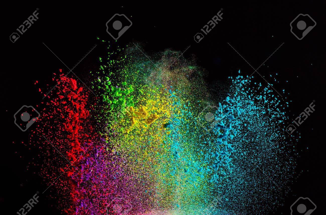 Explosión De Polvo De Color Sobre Fondo Negro. Congelar El ...