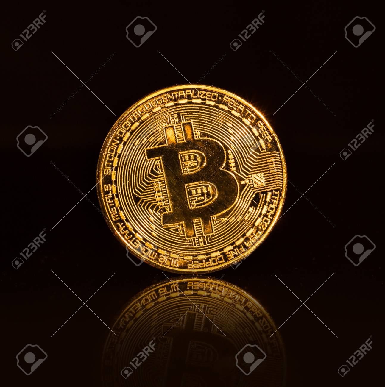 3af0ad03734 Bitcoin gold coins on black background. Virtual cryptocurrency concept.  Stock Photo - 93569027