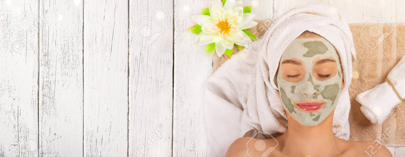 Young healthy woman with face clay mask. - 94295963