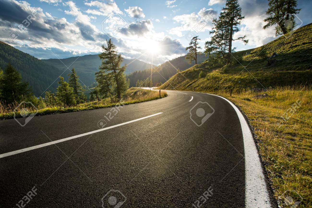 Asphalt road in Austria, Alps in a summer day. - 99219175