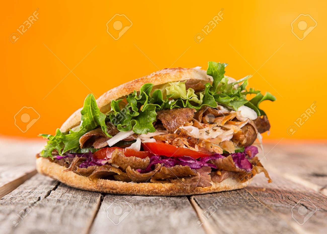 Turkish Doner Kebab Sandwich on wooden background. - 155934436