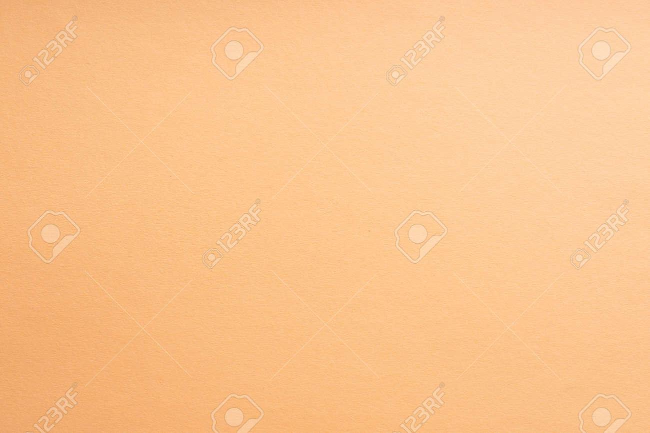 Paper background coral color. Rough paper texture. Closeup. Macro - 123825843
