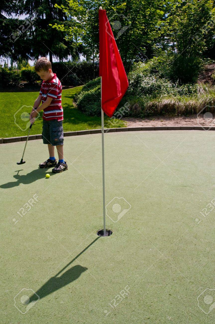 A relaxing day playing putt-putt golf as a child. Stock Photo - 3187022
