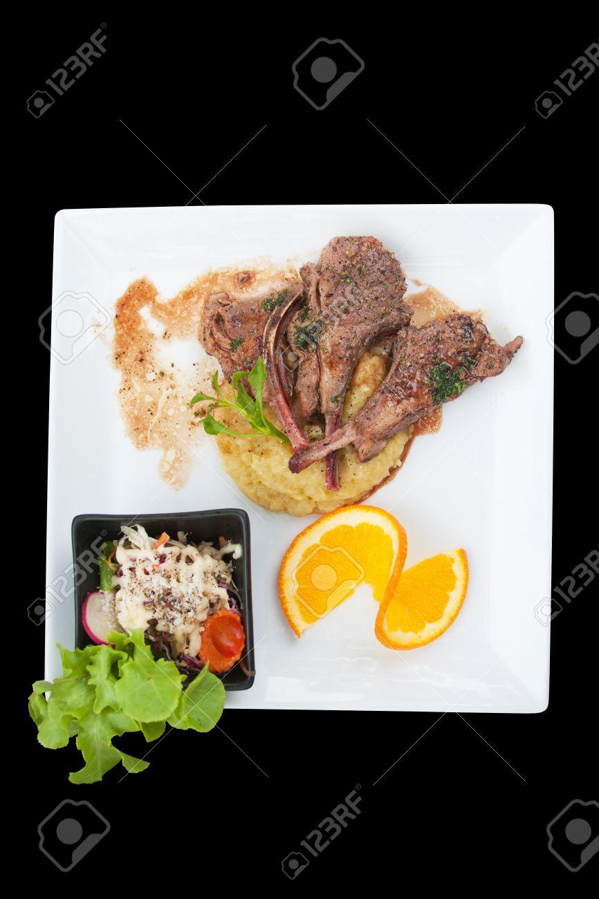 top view lamb steak isolated black Standard-Bild - 15550286