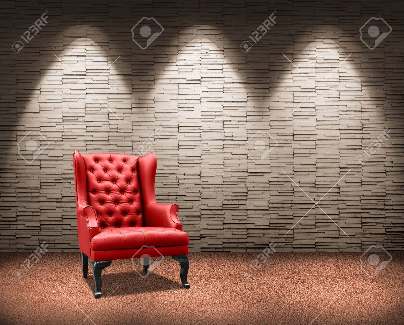 room with lighting on red armchair. Standard-Bild - 18399424