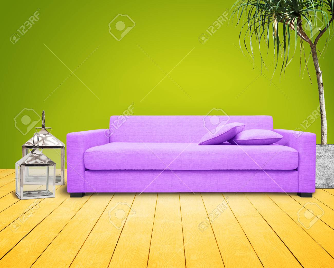 Living-room With Green Wall And Purple Couch. Stock Photo - 23879417
