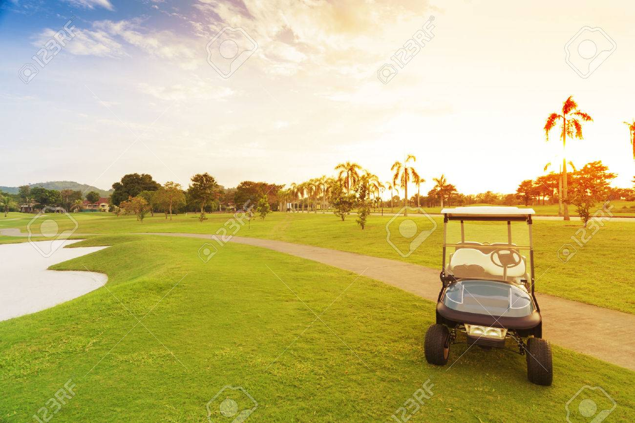 golf car with sun set in golf course. Standard-Bild - 36166184