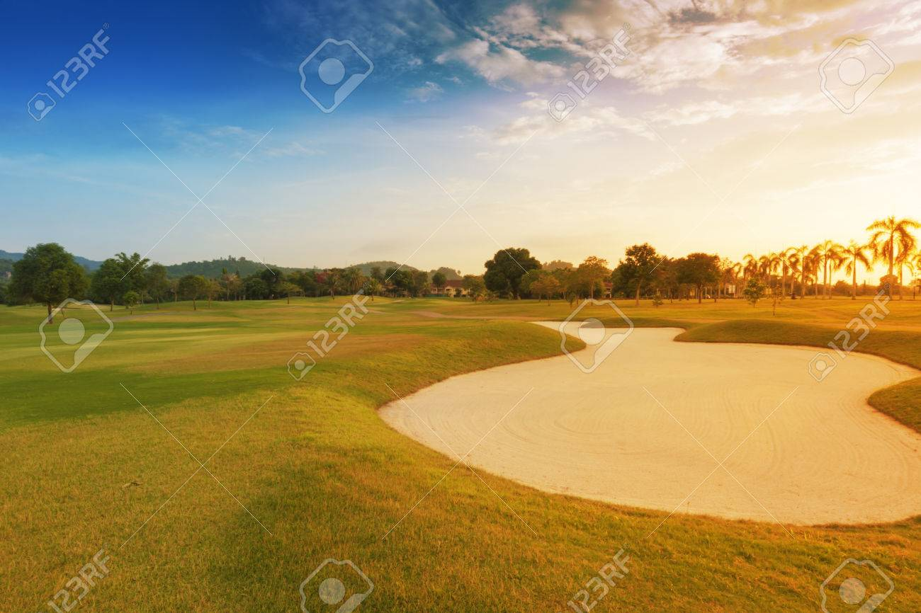 sand trap in golf course with sun set. Standard-Bild - 36166186