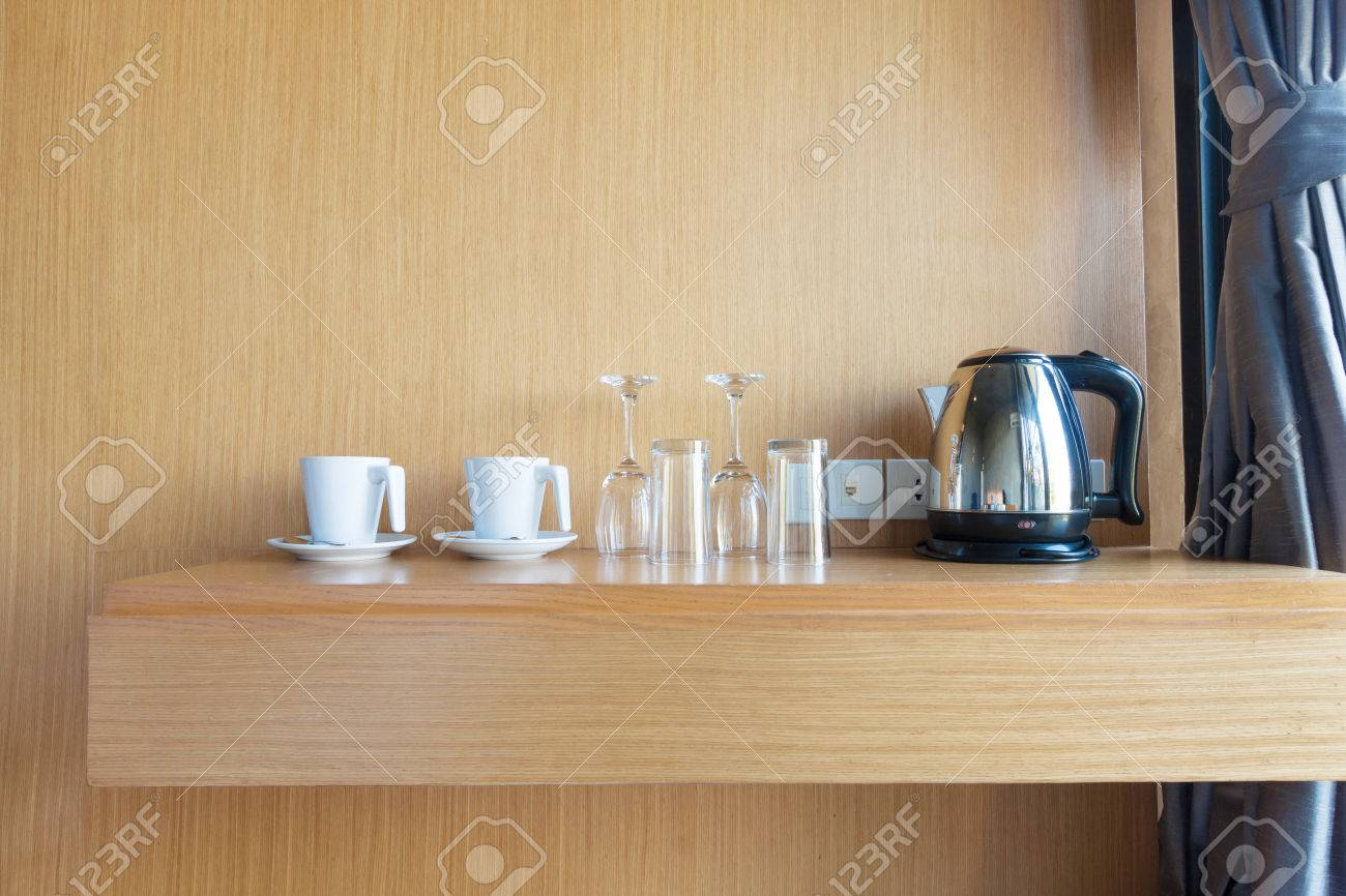 prepared cup , glass and electric kettle on wood shelf in luxury hotel room. Standard-Bild - 43284187