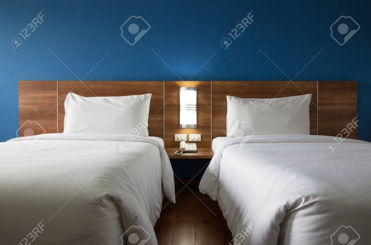 Picture of: Twin Bed With Wood Headboard Stock Photo Picture And Royalty Free Image Image 70742842