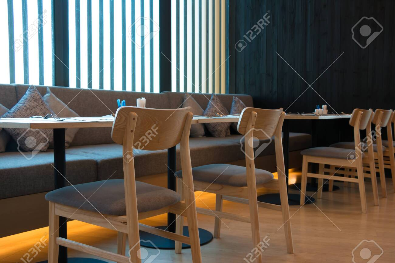 Modern Interior Restaurant Decorated With Wood Floor Wood Furniture Stock Photo Picture And Royalty Free Image Image 142571002