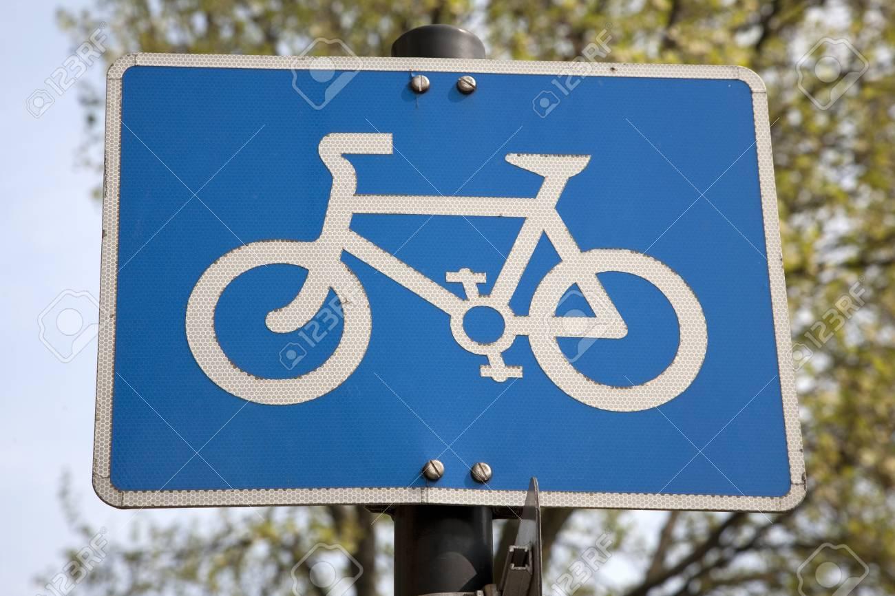 Blue Bike Lane Sign in Urban Setting Stock Photo - 9987437