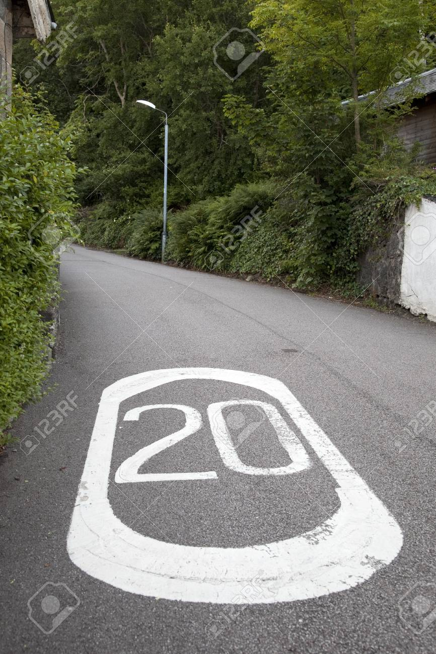 Twenty Mile Per Hour Speed Limit Markings on Rural Road Stock Photo - 16762010