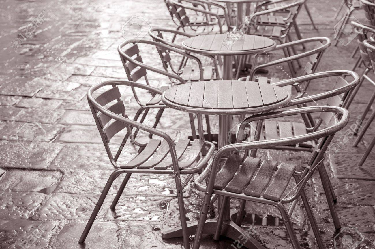 Cafe Chairs And Tables In Florence, Italy In Black And White Sepia Tone  Stock Photo