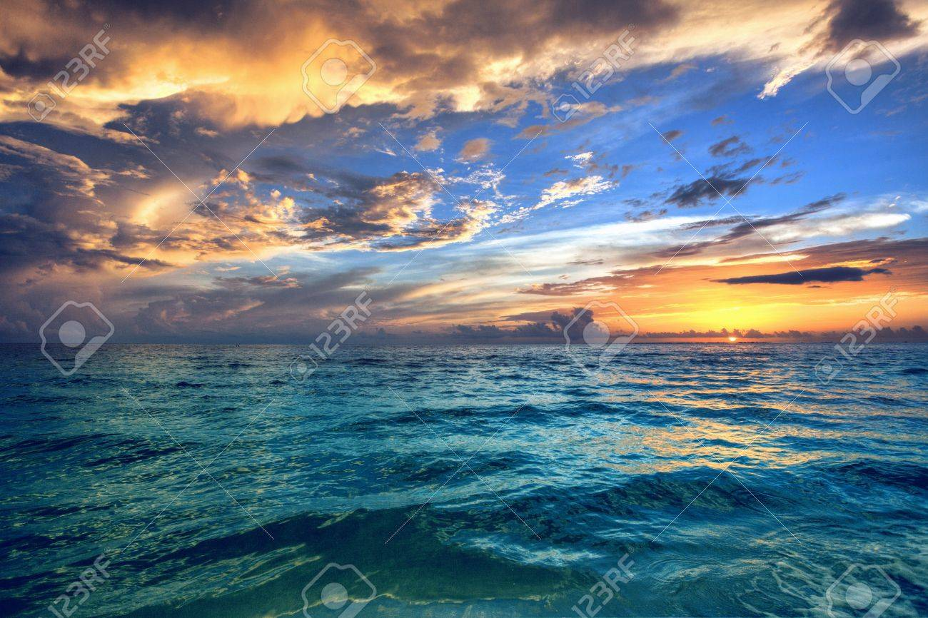 Beautiful Beach Sunset With Tropical Ocean Waters Stock Photo