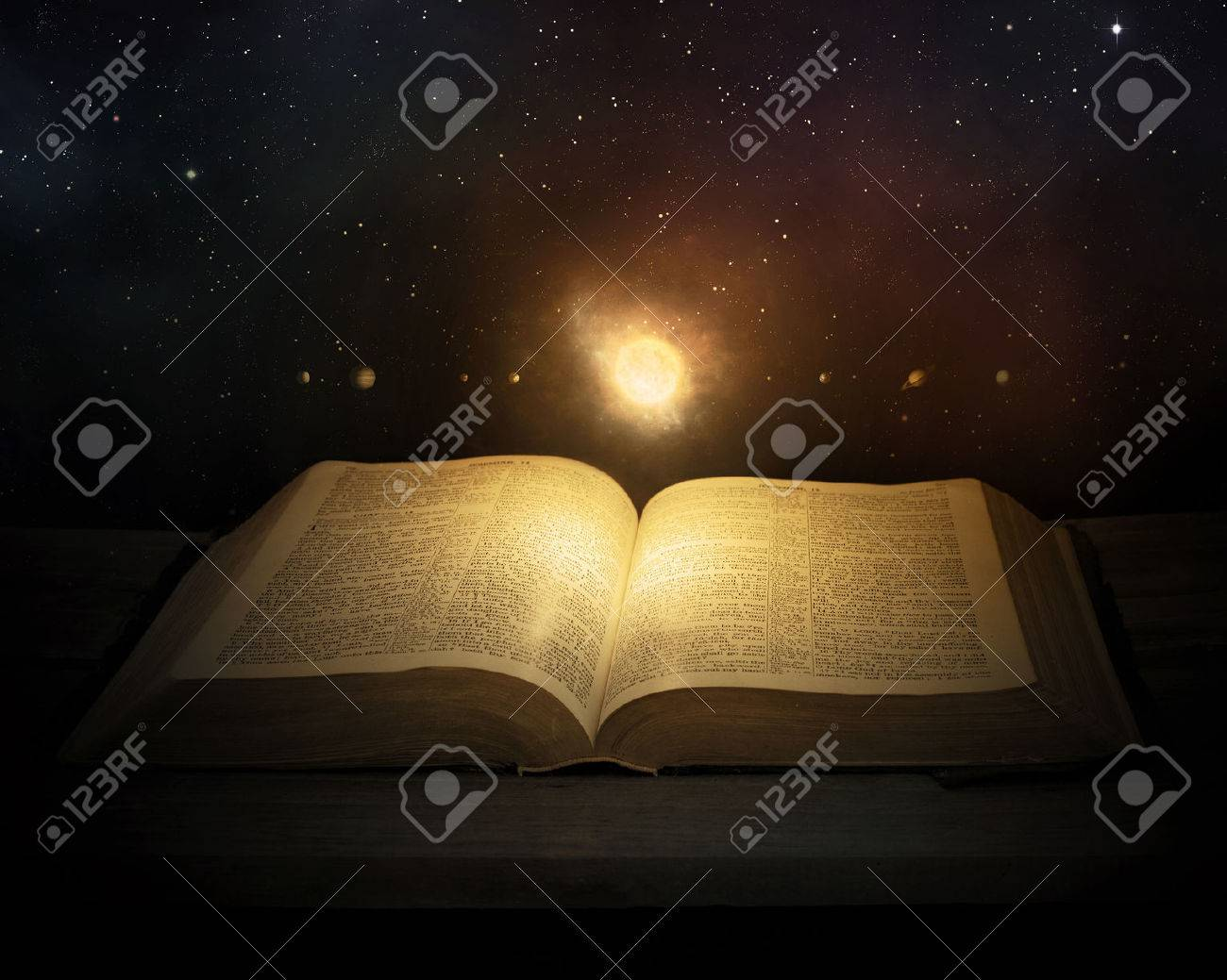 the solar system and stars floating above the pages of the bible