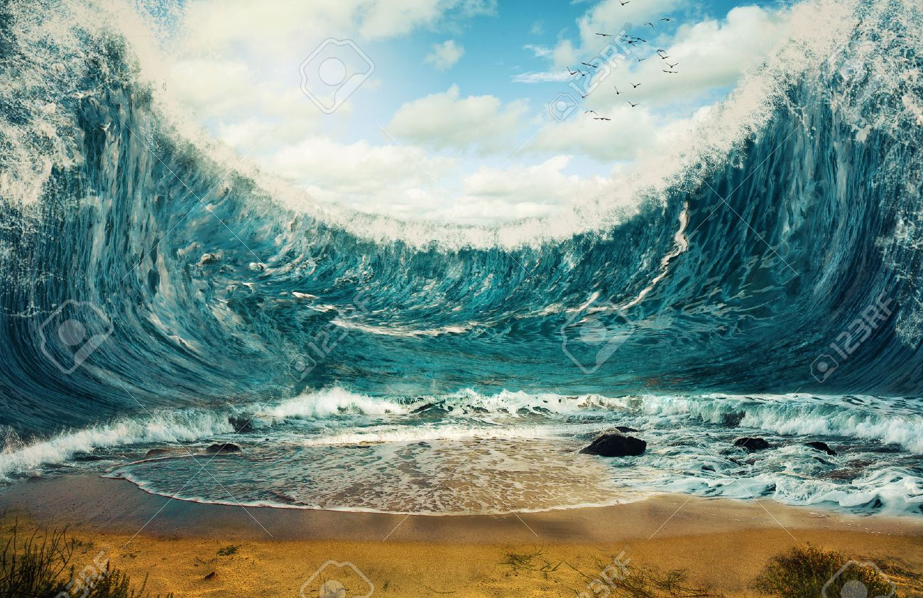Surreal image of huge waves surrounding dry sand. - 40236603