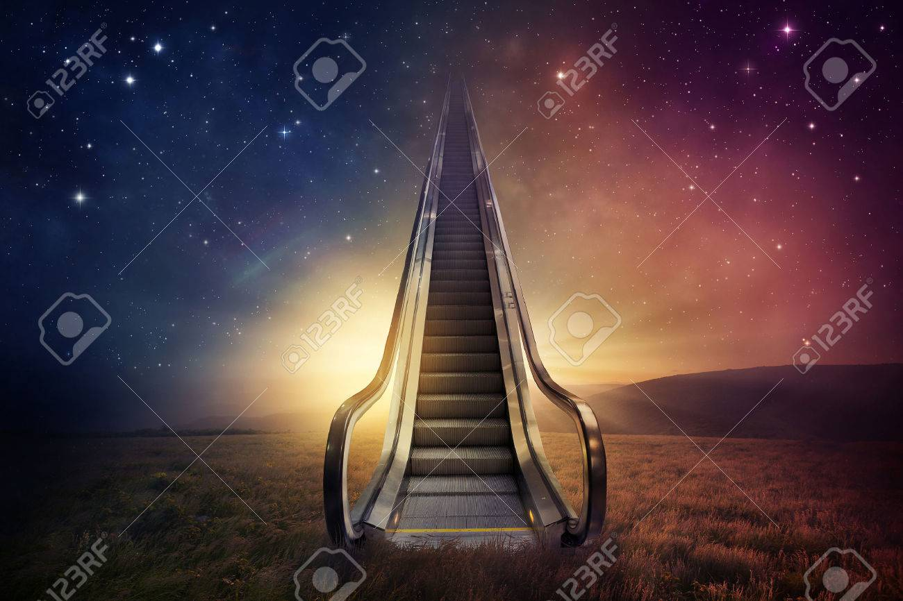 An escalator goes up to the night sky. - 42318022