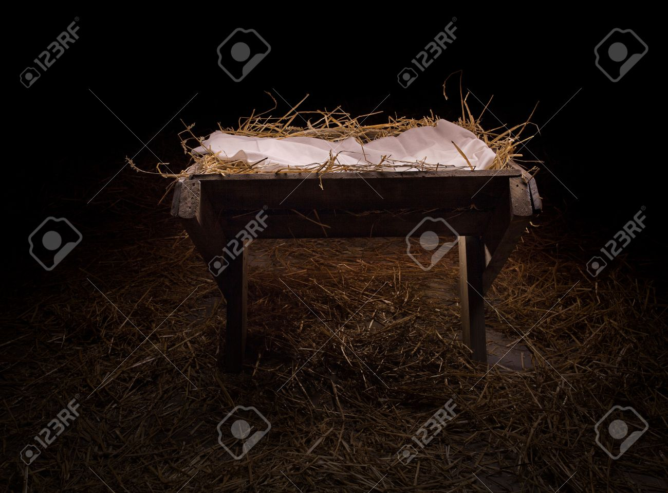 Empty manger in the straw at night. - 47403846