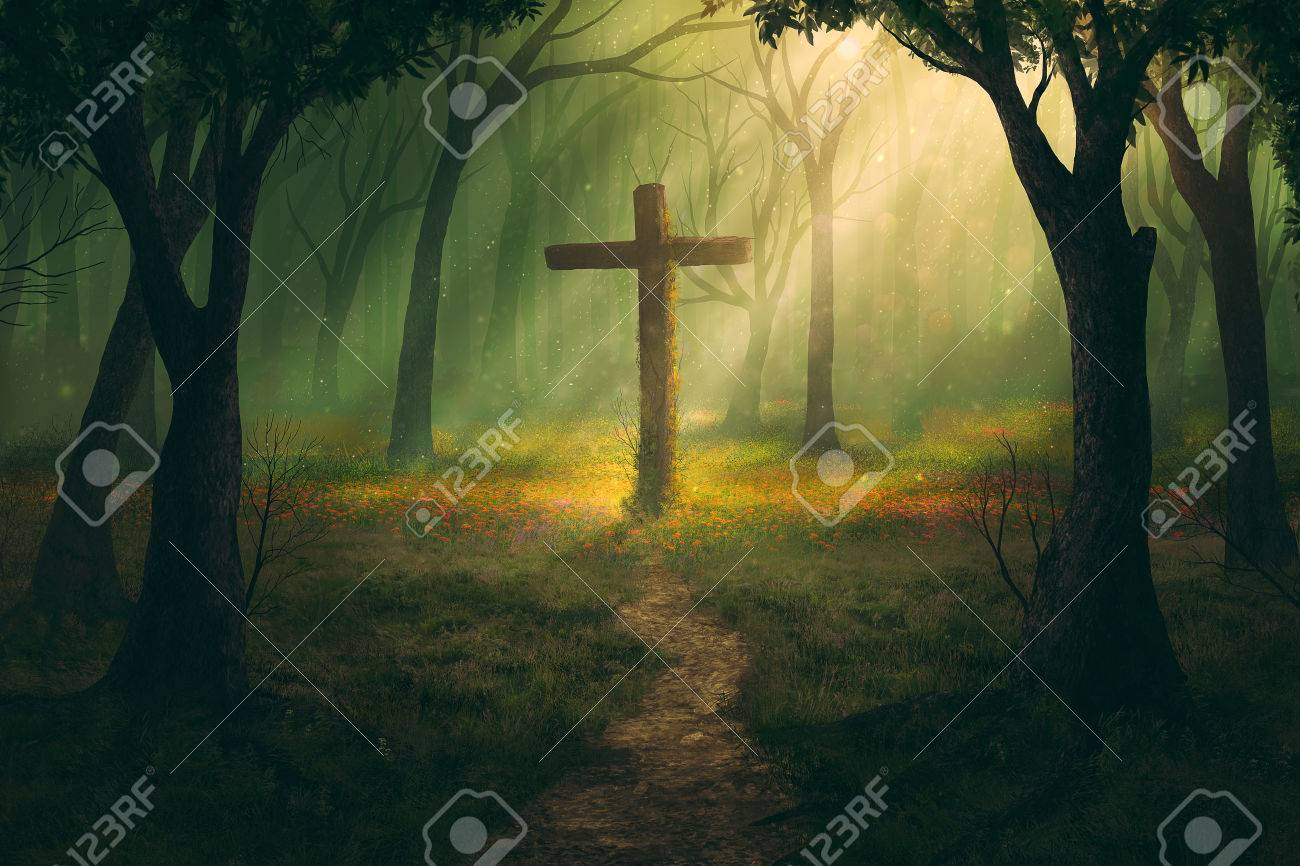 A single cross in the middle of a forest. - 50632420